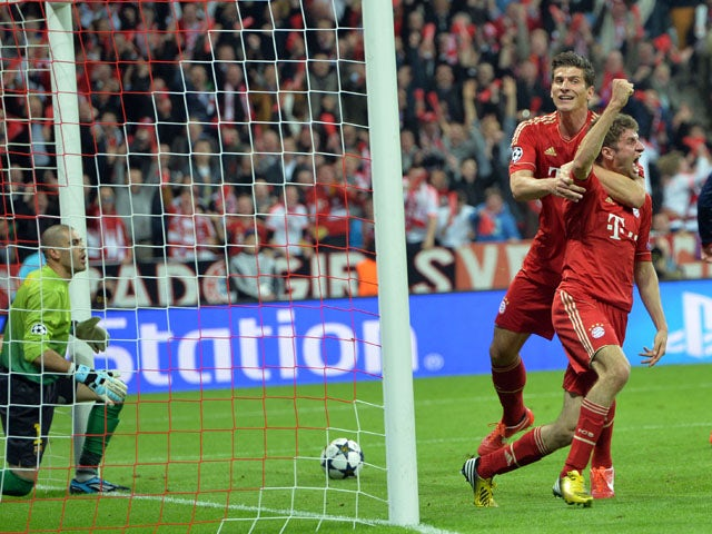 Bayern's Thomas Muller celebrates scoring against FC Barcelona during the Champions League semi final first leg on April 23, 2013
