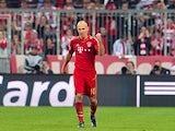 Bayern's Arjen Robben celebrates scoring his side's third goal against Barcelona on April 23, 2013