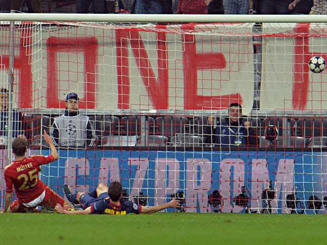 Bayern's Thomas Muller scores his second goal against FC Barcelona during the Champions League semi final first leg on April 23, 2013