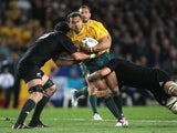 Australia's Digby Loane is tackled by New Zealand's Sam Whitelock and Richie McCaw on Octeober 16, 2011