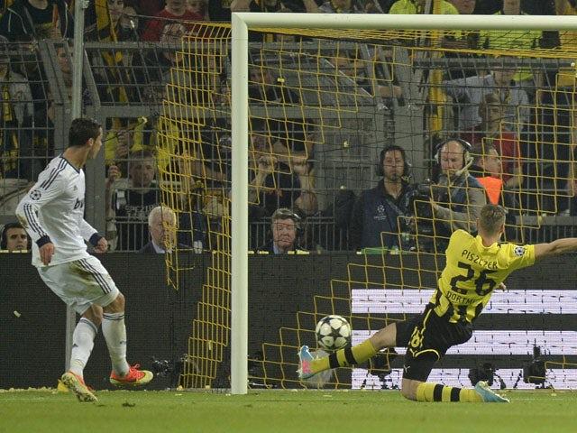 Real Madrid's Cristiano Ronaldo scores during the Champions League semi final match against Borussia Dortmund on April 24, 2013