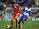 QPR's Esteban Granero shields the ball from Reading's Jobi McAnuff on April 28, 2013