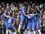 Chelsea players congratulate Frank Lampard after a penalty against Swansea on April 28, 2013