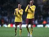 Arsenal's Laurent Koscielny and Per Mertesacker applaud the fans after the match against Aston Villa on November 24, 2012