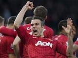 Manchester United's Robin van Persie celebrates scoring against Aston Villa on April 22, 2013