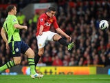 Manchester United's Robin van Persie scores his second goal against Aston Villa on April 22, 2013