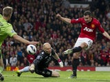 Manchester United's Robin van Persie scores his third goal against Aston Villa on April 22, 2013