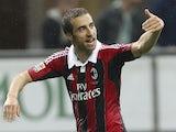 Milan's Matieu Flamini celebrates a goal against Catania on April 28, 2013