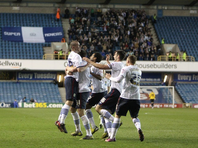 Blackburn Rovers' David Jones celebrates with teammates after scoring against Millwall on April 23, 2013