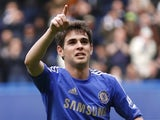 Chelsea midfielder Oscar celebrates a goal against Swansea on April 28, 2013