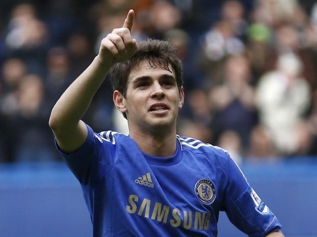 Chelsea midfielder Oscar celebrates a goal against Swansea on April 28, 2013