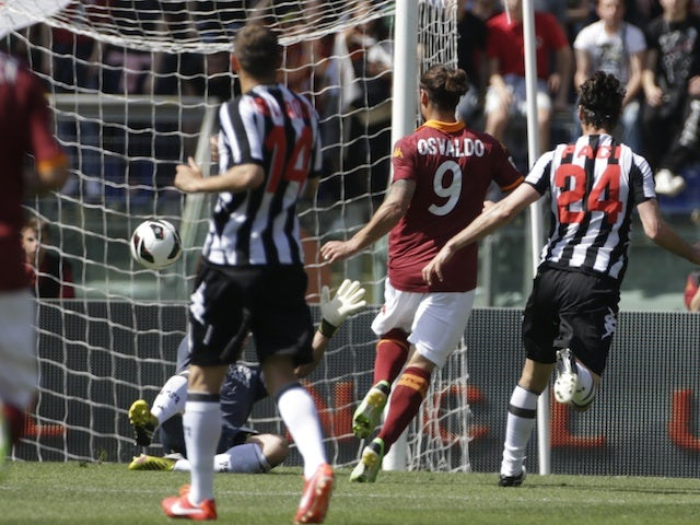 Roma's Pablo Osvaldo scores against Siena on April 28, 2013