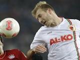 Ragnar Klavan of Augsburg in action against Bayern Munich on December 18, 2012