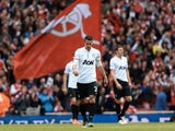 United forward Robin Van Persie walks away after going down 1-0 to former side Arsenal on April 28, 2013