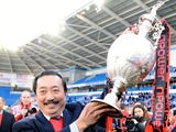 Cardiff chairman Vincent Tan celebrates his team winning The Championship on April 27, 2013