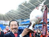 Cardiff chairman Vincent Tan celebrates his team winning The Championship on April 27, 2013
