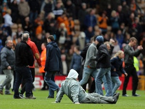 Police probe Wolves pitch invasion