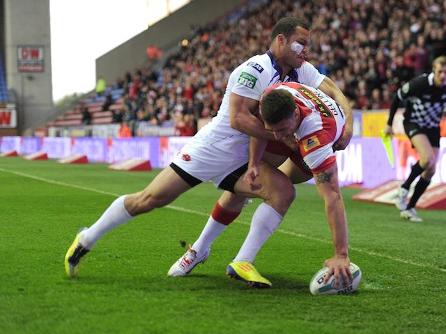 Wigan's Anthony Gelling touches down a try during the game with Salford City Reds on May 3, 2013