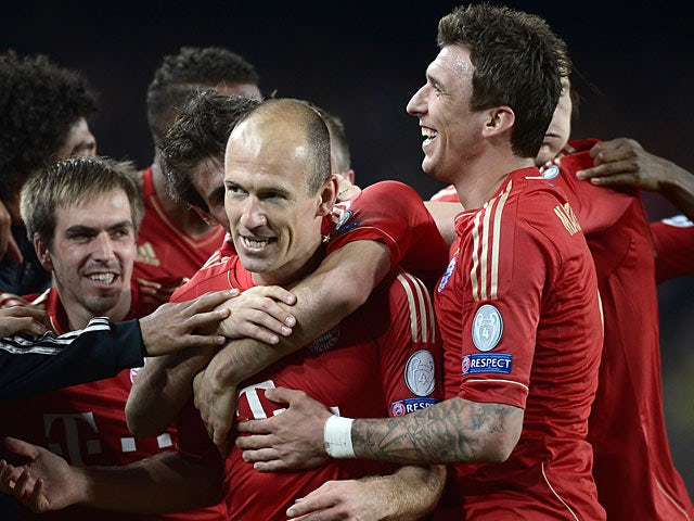 Bayern forward Arjen Robben is mobbed by team mates after scoring the opening goal against Barcelona on May 1, 2013