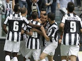 Juve midfielder Arturo Vidal is mobbed by teammates after a goal against Palermo on May 5, 2013