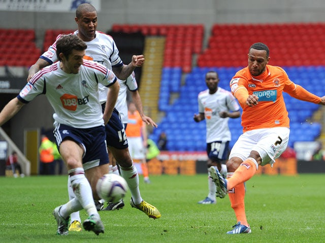 Blackpool's Matt Phillips scores the first goal against Bolton Wanderers on May 4, 2013