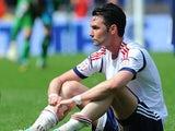 Bolton Wanderers Chris Eagles sits dejected after his teams 2-2 draw with Blackpool on May 4, 2013