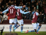 Villa's Christian Benteke celebrates his hat-trick goal against Sunderland on April 29, 2013