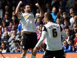 Peterborough United's Lee Tomlin celebrates scoring against Crystal Palace in the Championship clash on May 4, 2013