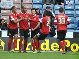 Barnsley's Chris O'Grady is congratulated after scoring against Huddersfield Town on May 4, 2013
