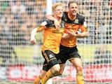 Hull City's Paul McShane celebrates scoring against Cardiff City on May 4, 2013