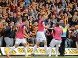 Bradford's James Hanson celebrates after scoring against Burton on May 5, 2013