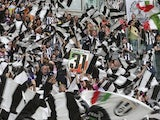 Juventus supporters celebrate their team clinching the Serie A title on May 5, 2013