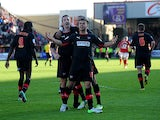 Brentford's Kevin O'Connor is celebrates with team mates after scoring the equaliser through a late penalty on May 4, 2013