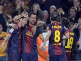 Barca's Leo Messi is congratulated after a goal against Real Betis on May 5, 2013