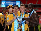 Newport County players celebrate their Blue Square Premier League victory over Wrexham on May 5, 2013
