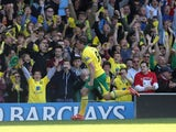 Norwich City's Grant Holt celebrates after scoring against Aston Villa on May 4, 2013