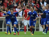 Leicester City players celebrate at the end of their match with Nottingham Forest on May 4, 2013
