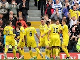Reading players celebrate in front of fans after their fourth goal against Fulham on May 4, 2013