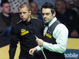Ronnie O'Sullivan and Barry Hawkins during the final of the World Snooker Championships on May 5, 2013