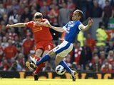 Steven Gerrard battles Leon Osman for possession during the Merseyside Derby on May 5, 2013