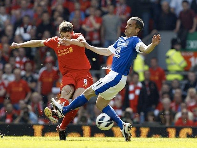 Steven Gerrard battles Leon Osman for possession during the Merseyside Derby on May 5, 2013