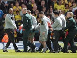 Watford's Jonathan Bond of is stretchered off during Championship match on May 4, 2013