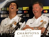Manchester United manager Alex Ferguson and Cristiano Ronaldo laugh during a news conference
