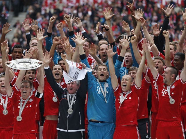 Munich's players celebrate with the Bundesliga trophy on May 11, 2013