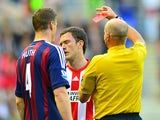 Craig Gardner is shown a red card by referree Lee Mason during the first half against Stoke on May 6, 2013