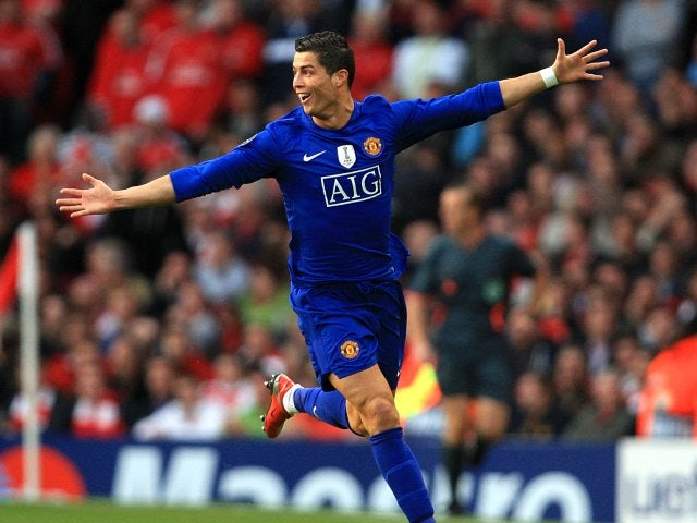 Cristiano Ronaldo celebrates scoring a free kick for Manchester United against Arsenal in 2009.