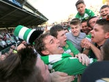 Tie winning goalscorer for Yeovil Town Ed Upson is mobbed by fans after the final whistle on May 6, 2013