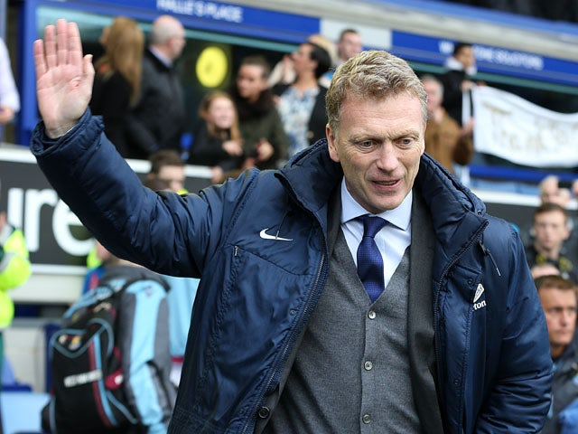 Everton manager David Moyes waves to fans during his last home match in charge of the club on May 12, 2013