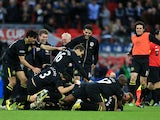 Wigan players celebrate winning the 2013 FA Cup on May 11, 2013