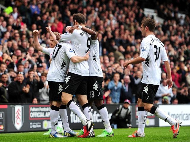 Fulham's Dimitar Berbatov celebrates scoring against Liverpool on May 12, 2013